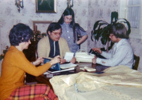 Adding up our first truck receipts. Clare, Bob, Kathleen & John Lind - 1973.