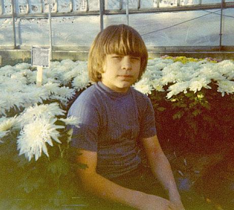 Joe Lind hiding in the Mums - 1973.
