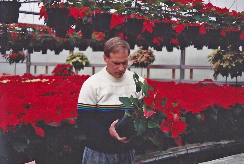 Rob Lind with poinsettias.